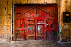 Old red wood gate stock images