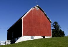 Old Red Wooden Barn. Against a blue sky background royalty free stock image