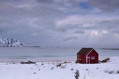 Old red Wooden Cabin In Northern Norway Stock Photography