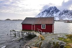 Old red Wooden Cabin In Northern Norway Stock Photo