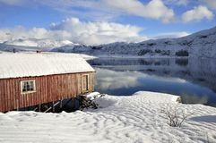 Old red Wooden Cabin In Northern Norway Stock Images