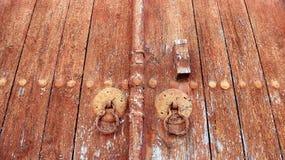 Old red wooden church door Stock Image