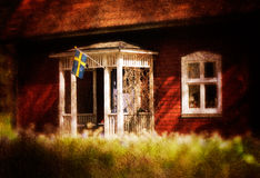 Old red wooden cottage in Sweden Royalty Free Stock Photography