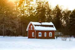 Old red wooden cottage, Sweden Royalty Free Stock Images