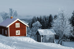Old red wooden cottages Stock Image