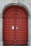 Old red wooden door in castle Royalty Free Stock Photography