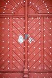 Old red wooden door in castle Stock Photos