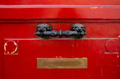 Old red wooden door with decorativel handle and Inbox Royalty Free Stock Image