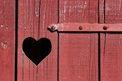 Old door with heart Stock Photos