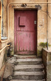 Old red wooden door with mailbox Royalty Free Stock Photography