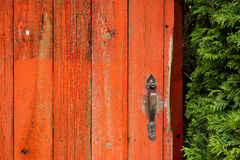 Old, Red, Wooden Door with Vintage Knob or Handle Stock Photos