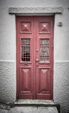 Old red wooden door with window and grid. Toned Stock Photo