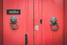 Old Red Wooden Doors with Lion Head Metal Knockers in Mdina, Mal Royalty Free Stock Photos