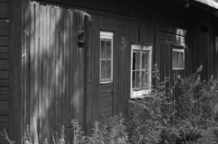 Old red wooden farm house in Dalarna in black and white stock images