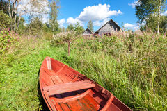 Old red wooden fishing boat at the lake Royalty Free Stock Photo