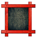 Old red wooden frame against a white background with black wood copy space in the cente Royalty Free Stock Photography