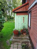 Old home door, stair and flowers, Lithuania Stock Photography