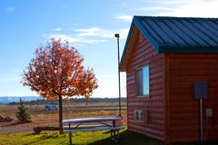 Old red wooden house with autumn tree in Bryce Canyon royalty free stock photos