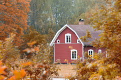 Old red wooden house in Sweden Royalty Free Stock Image