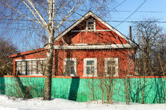 Old red wooden house in winter Stock Images