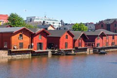 Old red wooden houses of Porvoo, Finland. Porvoo, Finland - June 12, 2015: Old red wooden houses on the river coast, Porvoo town, Finland Royalty Free Stock Photos