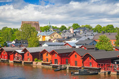 Old red wooden houses on river coast. Porvoo Royalty Free Stock Image