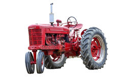 Old Red Work Tractor Isolated On White. A red tractor isolated on white with plenty of copy space Royalty Free Stock Photo
