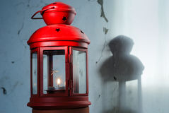 Old red xmas lantern. On cracked stucco wall Royalty Free Stock Images