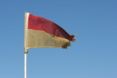 Old Red and Yellow Lifeguard flag. On a South African Beach stock photography