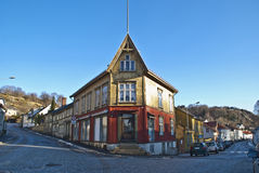 Old red and yellow wooden house in Halden. Stock Photos