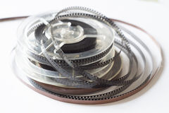 Old reels with black and white film and magnetic tape Stock Photo