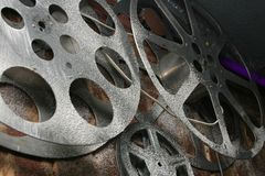 Old Reels Film. On brick wall Stock Image