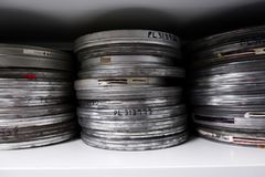 Old reels of film in silver cans royalty free stock image