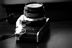 An old reflex camera from the seventies. Laying over a table Royalty Free Stock Photography