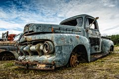 Derelict Truck from a bygone era in Alaska. An old relic truck sits idle near Chicken, Alaska, reminder of a bygone era in Alaska royalty free stock image