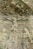 Old relief of Jesus Christ in a sandstone rock Stock Photography