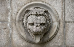 Old relief with lion head Stock Photo