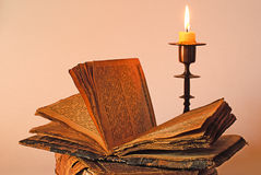 Old religious book and candlestick Royalty Free Stock Image