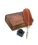 Old religious book, inkwell and pen on a white background Stock Photos