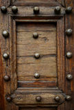 Old renaissance doors. Detail of old renaissance doors with clouts stock images