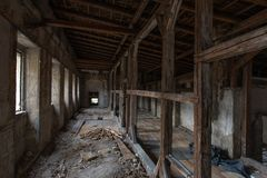 Old renovated palace, destroyed interior. Tunnel with wooden rafters stock image