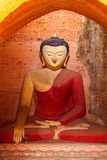Old renovated sculpture of a seated Buddha Royalty Free Stock Image
