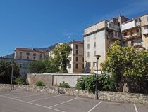 Old rental houses in corte city corsica with blue sky background. And empty parking place royalty free stock photo