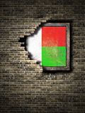 Old Republic of Madagascar flag in brick wall. 3d rendering of a Republic of Madagascar flag over a rusty metallic plate embedded on an old brick wall Stock Photography