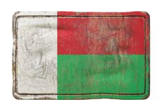 Old Republic of Madagascar flag. 3d rendering of a Republic of Madagascar flag over a rusty metallic plate. Isolated on white background Royalty Free Stock Photos