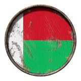Old Republic of Madagascar flag. 3d rendering of a Republic of Madagascar flag over a rusty metallic plate. Isolated on white background Royalty Free Stock Image