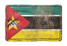 Old Republic of Mozambique flag. 3d rendering of a Republic of Mozambique flag over a rusty metallic plate. Isolated on white background Royalty Free Stock Images