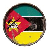 Old Republic of Mozambique flag. 3d rendering of a Republic of Mozambique flag over a rusty metallic plate. Isolated on white background Royalty Free Stock Photos