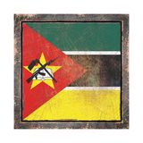 Old Republic of Mozambique flag. 3d rendering of a Republic of Mozambique flag over a rusty metallic plate wit a rusty frame. Isolated on white background Stock Photo