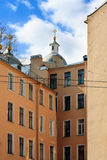 Old residential building. Dome of the Orthodox Church over old residential building in St.Petersburg Russia Stock Photography